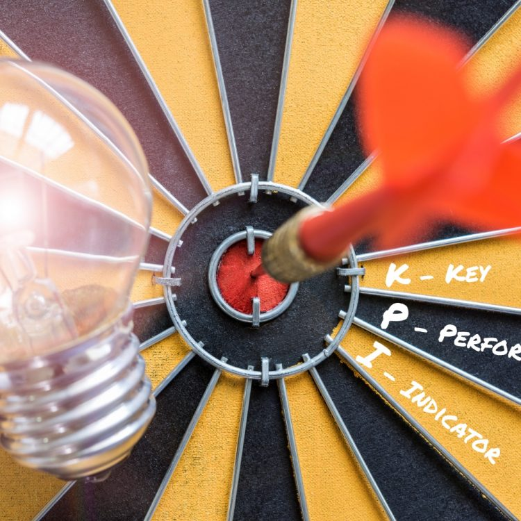 KPI key performance indicator with idea bulb lamp and dart successful on bullseye, Smart goals concept for success business